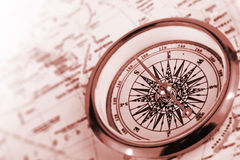 Compass on a map. In brown key stock image