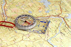 Compass and map. Compass lying on a  topographical  map Royalty Free Stock Photo