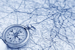 Compass and map. A compass on a road map pointing north Stock Photography