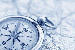 Compass and map. A compass on a road map Royalty Free Stock Photos