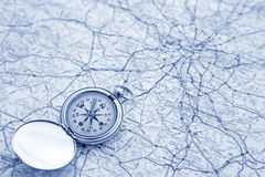 Compass and map. A compass on a road map pointing north Stock Photos