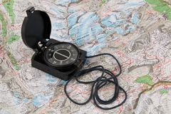 Compass on the map. Of italian Alps stock image