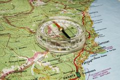 Compass on map. As an abstract for travelling royalty free stock photography
