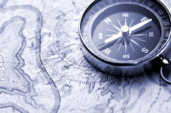 Compass on map. Classic compass on a hiking map Royalty Free Stock Images