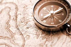 Compass on map. Of a canyon Royalty Free Stock Image