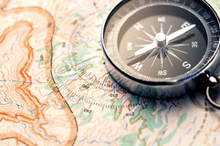 Compass on map. Classic compass on a hiking map Stock Photo