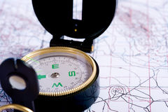 Compass on a map. A compass lying on top of a topographical map Royalty Free Stock Photos