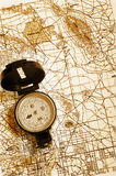 Compass on a map. A compass lying on top of a topographical map Stock Photography