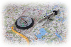 Compass on a map. Compass and compasses on a map Royalty Free Stock Photos