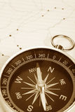 Compass and map Stock Photos
