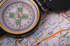 Compass on map. Close up from a compass on a map Royalty Free Stock Images