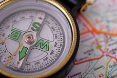 Compass on map. Close up compass on map Royalty Free Stock Photo