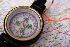 Compass on map. Compass on travel map Royalty Free Stock Image