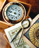 Compass and Map. Antique compass and maps with calipers Stock Images