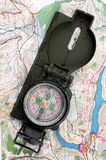 Compass and map. Finding way with compass and map Stock Photography