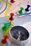 Compass and map. Compass on surface of the geographical map Stock Photo