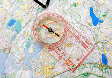 Compass on a map. The big compass on a sports map for orientation Royalty Free Stock Photo