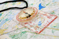 Compass on a map. The big compass on a sports map for orientation Royalty Free Stock Photos