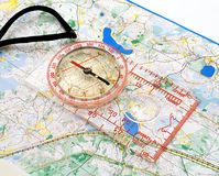 Compass on a map. The big compass on a sports map for orientation Stock Photos