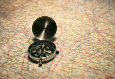 Compass on a map. Planning your holidays Royalty Free Stock Image
