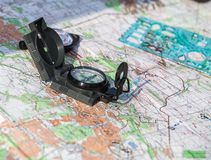 Compass on a map of the area royalty free stock photos