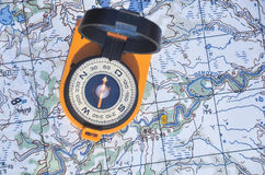 Compass on the map. Stock Photography