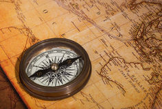 Compass on a Map. Brass compass on a vintage looking map Stock Photo