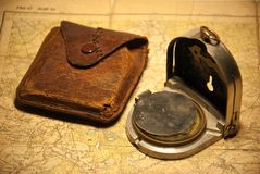Compass & map. A compass with a case and a map Stock Image