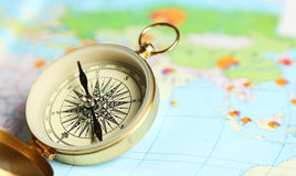 Compass on a map close up Royalty Free Stock Photos