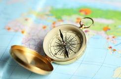 Compass on a map close up Royalty Free Stock Image