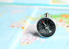 Compass on map, close up Royalty Free Stock Photo
