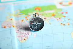 Compass on map, close up Stock Photos