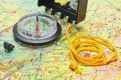 Compass on the map closeup Royalty Free Stock Photos