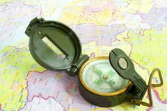 Compass on a map. Compass on a colorful map Royalty Free Stock Photos