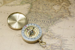 Compass and map. A device that facilitates terrain orientation by reference to the magnetic poles of the Earth and the compass Royalty Free Stock Photos