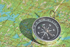 Compass & map - friends travelers. Royalty Free Stock Photo