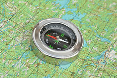 Compass & map - friends travelers. Royalty Free Stock Images