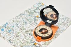 Compass & map - friends travelers. Stock Photos