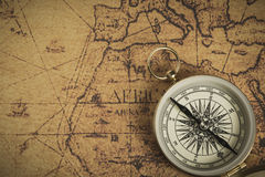 Compass on a map. Golden compass on an old map. Selective focus Royalty Free Stock Photos