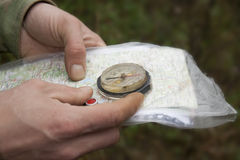 Compass and map in hand. closeup. Royalty Free Stock Image