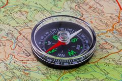 Compass and map. A magnetic compass being used to orientate a map to the ground Stock Photography