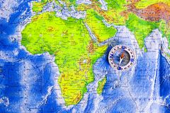 Compass on map. The magnetic compass is located on a geographic map. Satellites adventure. Travel concept. Compass on map. The magnetic compass is located on a royalty free stock image