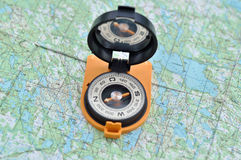 Compass on the map. Royalty Free Stock Images
