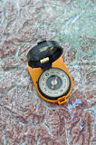 Compass on the map. Royalty Free Stock Photo