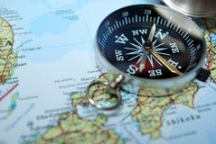 Compass on map. Magnetic compass on map with focus on scale Stock Images