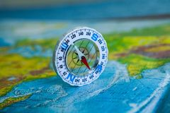 Compass on map. The magnetic compass is located on a geographic map. Satellites adventure. Travel concept. Compass on map. The magnetic compass is located on a royalty free stock photo