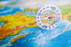 Compass on map. The magnetic compass is located on a geographic map. Satellites adventure. Travel concept. Compass on map. The magnetic compass is located on a stock images