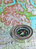 Compass on the map. Royalty Free Stock Photography