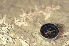 Compass at map. Metal compass at paper map Royalty Free Stock Photo