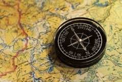 Compass and map. Modern compass over world natural map Royalty Free Stock Image